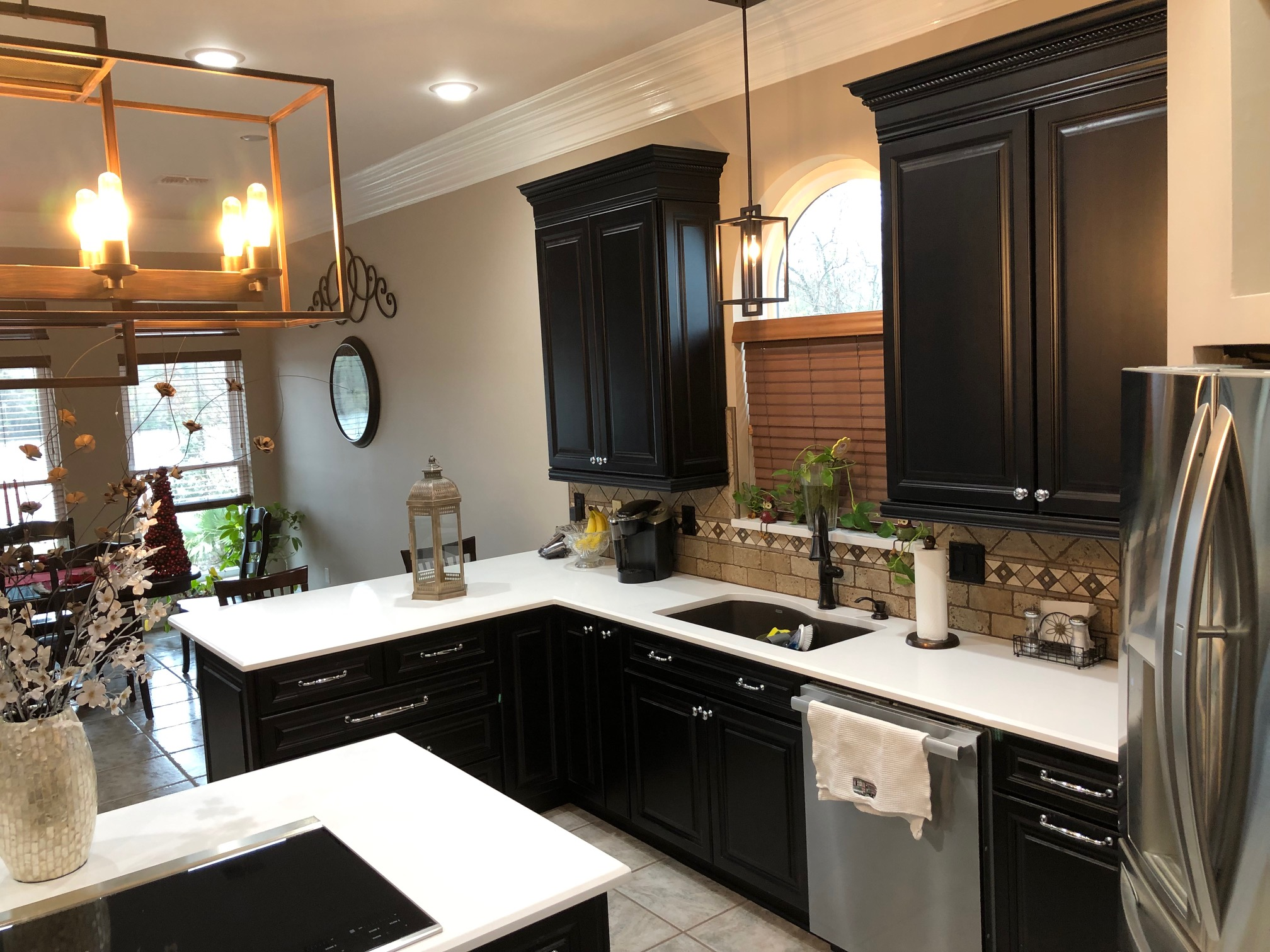 Wellborn Forest Black cabinetry white quartz counter tops
